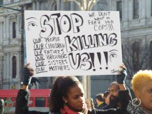 Young-Woman-Holds-Sign-at-Muslim-at-Police-Violence-Rally-e1419876462290